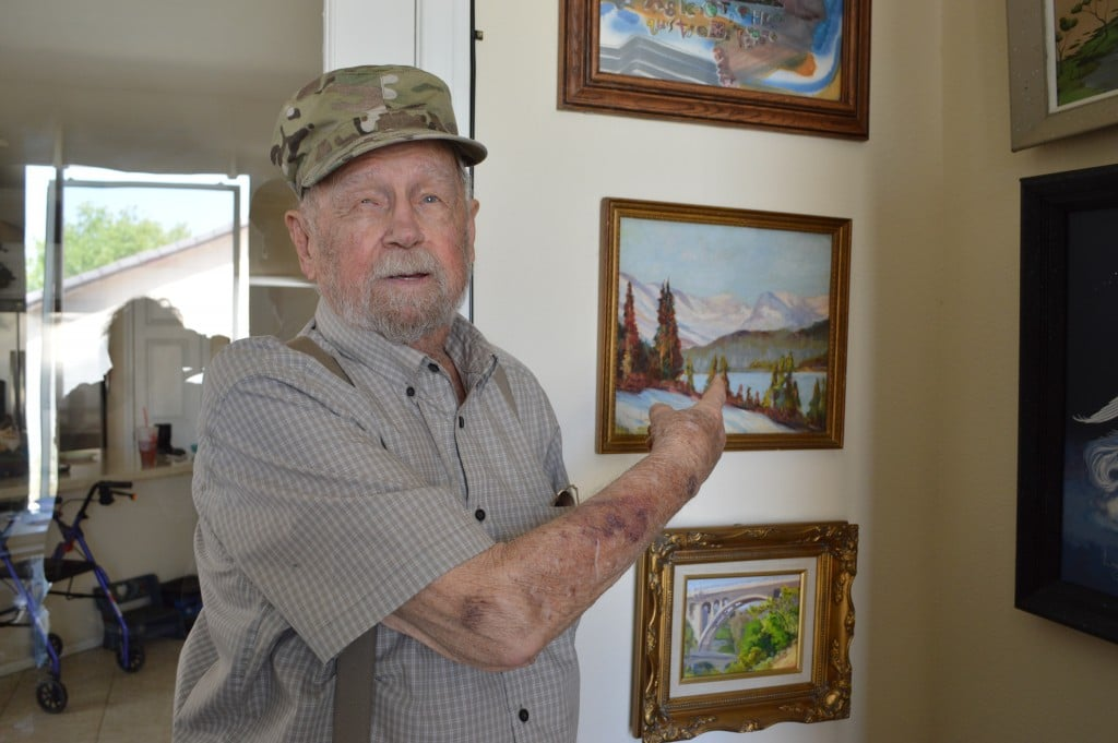 Jim Lambell, showing off the first painting he ever made!